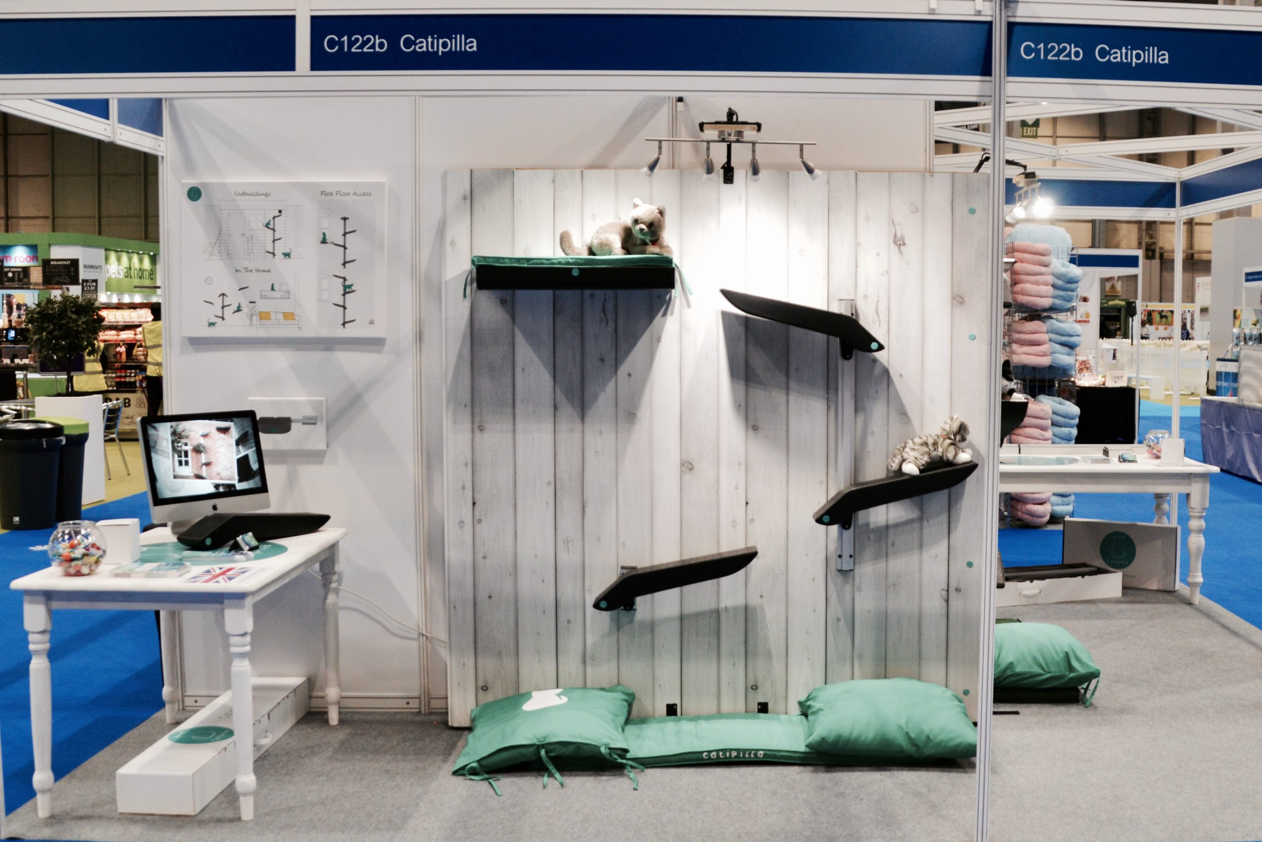 Catipilla exhibition booth with real cats