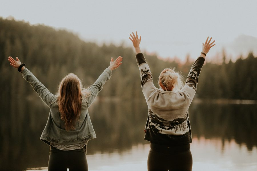 two women lifting up their hands